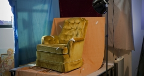 Gold Chair and Blue Curtain
